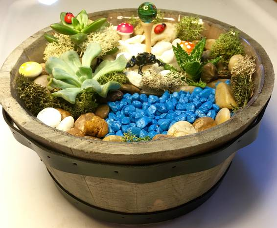 A Succulent Terrarium Whiskey Barrel plant nite project by Yaymaker