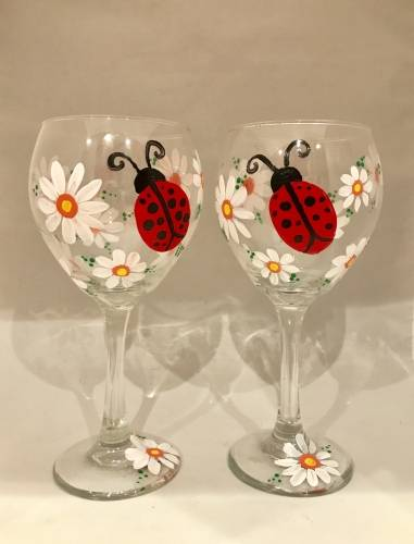 A Ladybug Luck Wine Glasses paint nite project by Yaymaker