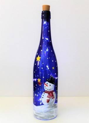 A Starstruck Snowman Wine Bottle with Fairy Lights paint nite project by Yaymaker