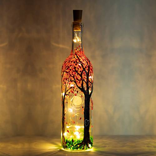 A Blossoming Forest Magic Wine Bottle with Fairy Lights paint nite project by Yaymaker