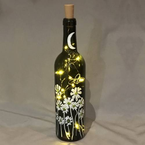 A Fireflies and Daisies Twinkle Lights Wine Bottle paint nite project by Yaymaker
