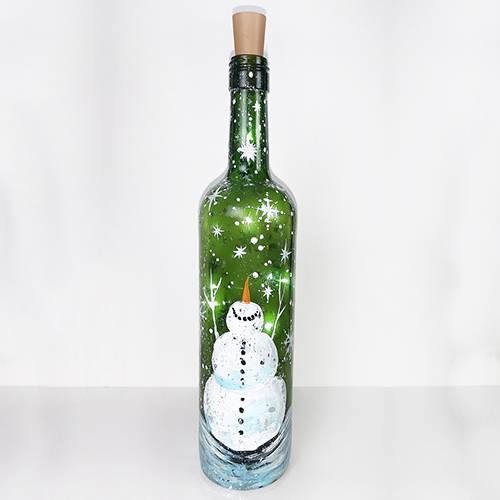 A Snowman in Snowstorm Wine Bottle with Fairy Lights paint nite project by Yaymaker