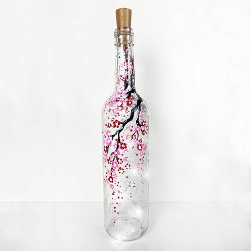 A Cherry Blossom Wine Bottle with Fairy Lights paint nite project by Yaymaker