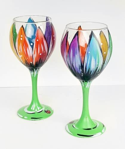A Rainbow Flower Wine Glasses with a Ladybug paint nite project by Yaymaker