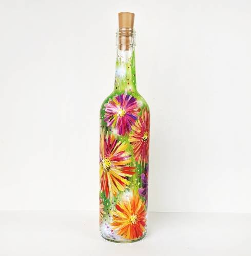 A Daisy Field Wine Bottle with Fairy Lights paint nite project by Yaymaker