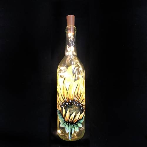 A Sunflower Wine Bottle with Fairy Lights paint nite project by Yaymaker