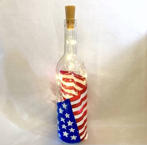 A Star Spangled Banner Wine Bottle with Fairy Lights paint nite project by Yaymaker