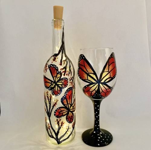A Social Butterfly Wine Bottle with Fairy Lights and Wine Glass paint nite project by Yaymaker