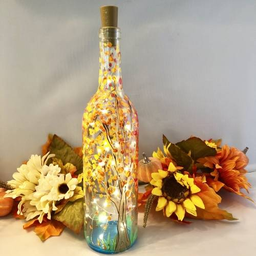 A Fall Trees by the Lake  Wine Bottle  Fairy Lights paint nite project by Yaymaker