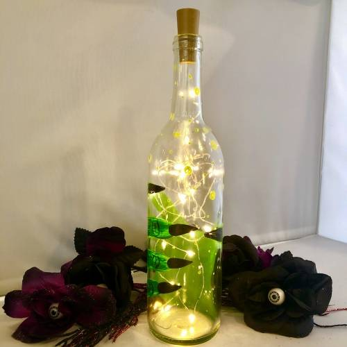 A Witches Magic Potion  Wine Bottle  Fairy Lights paint nite project by Yaymaker