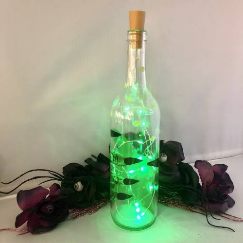 A Wicked Magic Potion Wine Bottles  Fairy Lights paint nite project by Yaymaker