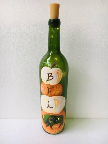 A BufFALLo Wine Bottle w Fairy Lights paint nite project by Yaymaker