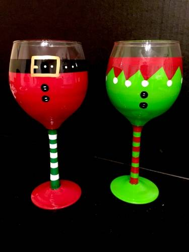 A Santa  Elf Wine Glasses paint nite project by Yaymaker