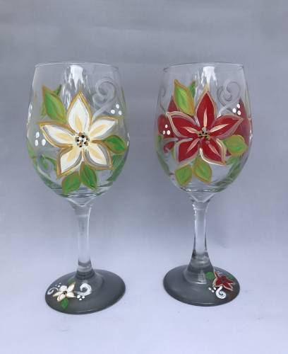 A Poinsettia Elegance Wine Glasses paint nite project by Yaymaker