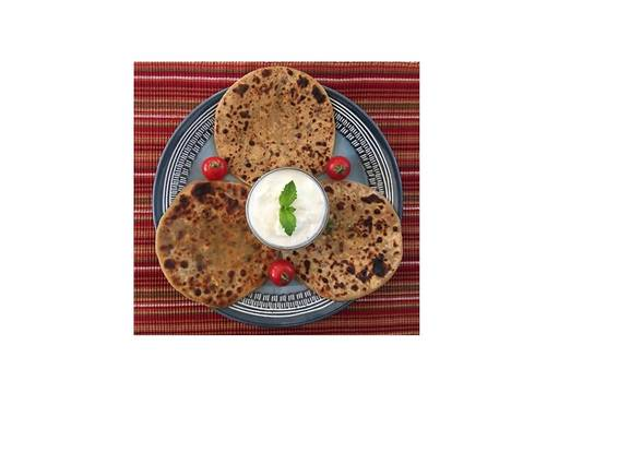 A Paneer Paratha bread and Cucumber Raita dip  Vegetarian experience project by Yaymaker